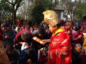 Tsikey Chokling Rinpoche blessing those in the courtyard on the last day of the drupchen.